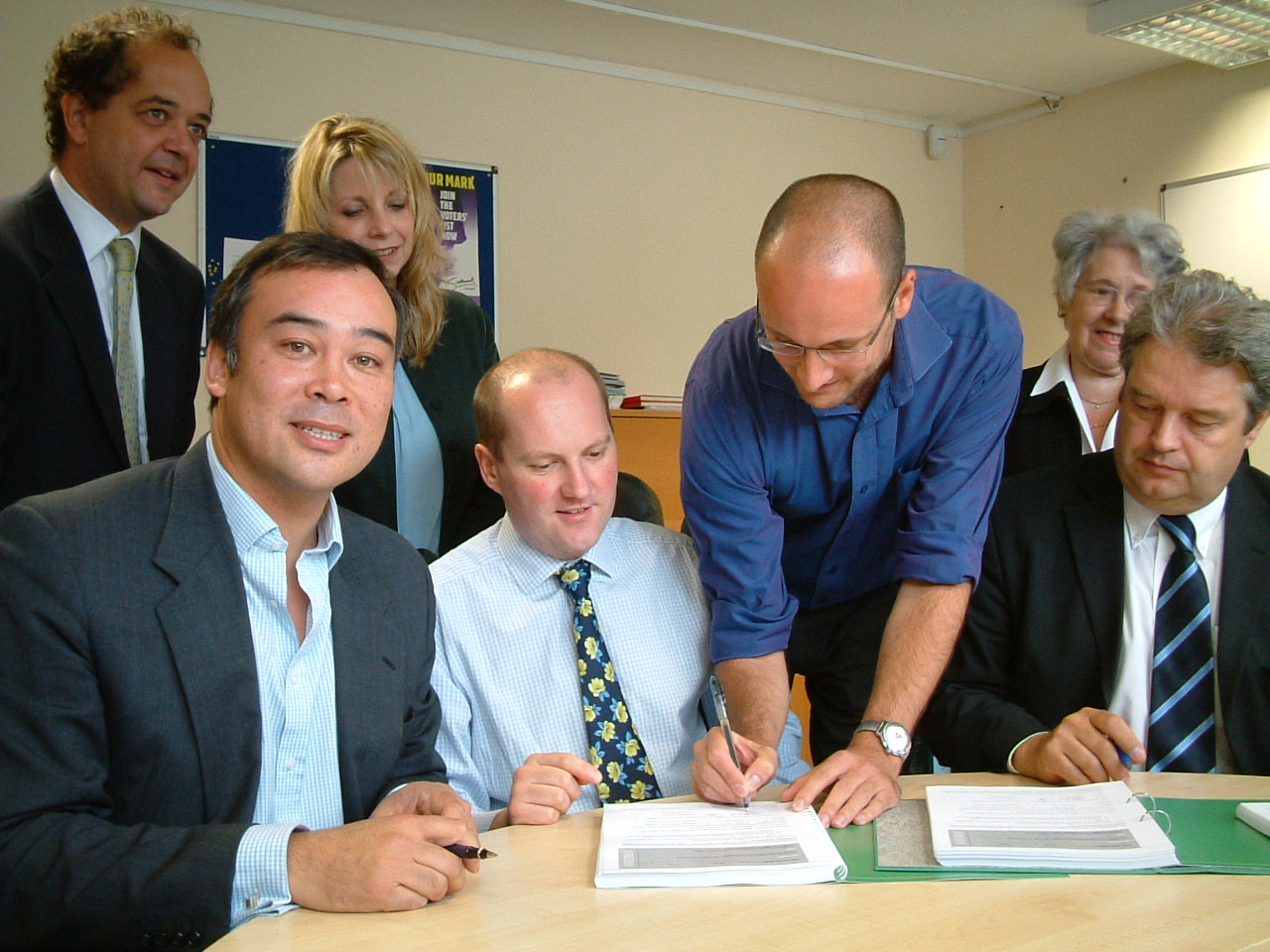 Photo of residents signing transition documents in the Estate Office